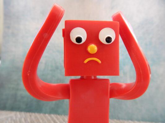 Rood poppetje met hoofdluis en armen omhoog